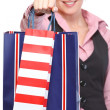 Happy woman giving shopping bags. Close up — Stock Photo #11550613