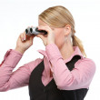 Woman looking through binoculars — Stock Photo #11550671
