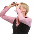 Woman looking through binoculars up. Side view — Stock Photo #11550676