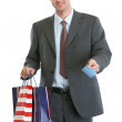 Royalty-Free Stock Photo: Man in suit holding shopping bags and credit card