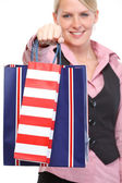 Happy woman giving shopping bags. Close up — Stock Photo
