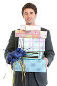 Man holding stack of gift boxes — Stock Photo