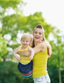 Portrait of happy mother and baby girl outdoors — Stock Photo