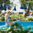 Mother with baby sitting in open air pool — Stock Photo