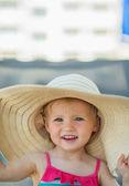 Portrait of baby in beach hat — Stock Photo