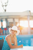 Portrait of dreaming woman at pool bar — Stock Photo
