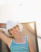 Happy woman laying on sunbed — Stock Photo