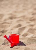 Baby bucket and shovel on the sandy beach — Stock Photo
