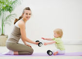 Mother and baby spending time in gym — Stock Photo