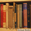 Wooden shelf with antique books — Stock Photo