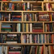 Stock Photo: Wooden shelves wall in bookstore