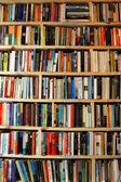 Bookstore wooden shelves wall — Stock Photo