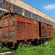 Stock Photo: Industrial building, old wagon