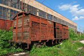 Industrial building, old wagon — Stock Photo
