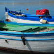 Blue and white fish boats — Stock Photo