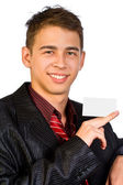 Young businessman is showing the advertisement. — Stock Photo