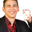 Young lucky gambler with cards — Stock Photo #11502938