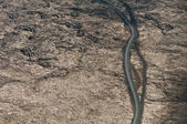 Road in deserted country from above — Stock Photo