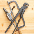 Hacksaw, adjustable spanner and drill — Foto de Stock