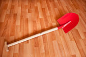 Red shovel — Stock Photo
