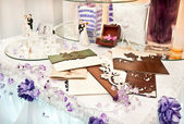 Table decorated with wedding objects — Stock Photo
