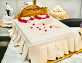 Wedding cake shaped bed — Stock Photo