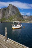 Fishing boat in fjord — Stock Photo