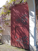 Red antique gate — Stock Photo