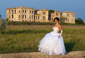 Full length portrait of bride with the ruins on the background — Stock Photo