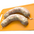 Raw chicken sausages for the grill — Stock Photo