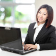 Business woman using computer at office — Stock Photo