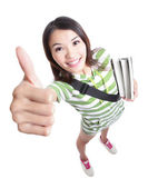 Excellence - girl student thumbs up hand gesture — Stock Photo