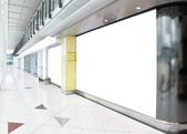 Blank billboard in shopping mall — Stock Photo