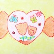 Child Painting - two hands holding sweet love heart — Stock Photo