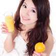 Woman smile drinking orange juice at home — Stock Photo