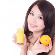 Woman smile holding orange juice — Stock Photo
