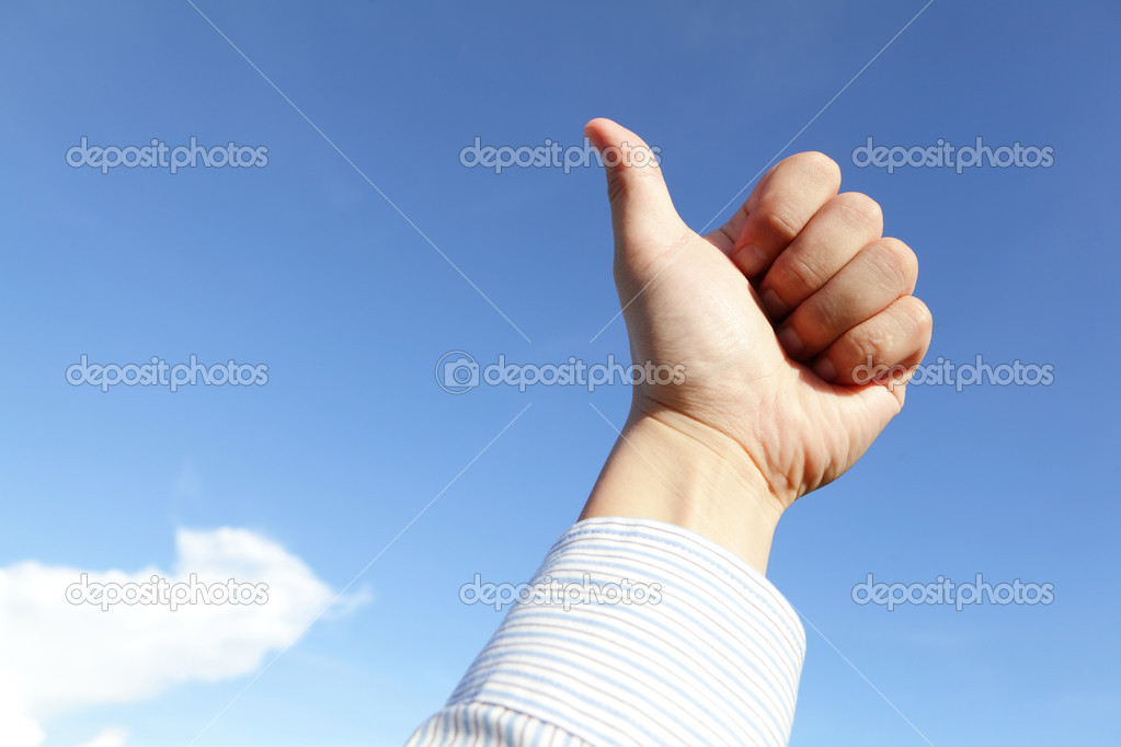 Good hand gesture close up with blue sky and white cloud — Stock Photo #11646572