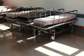 Corridor in hospital with beds — Stock Photo