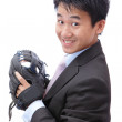 Stock Photo: Young Business Man pitching baseball