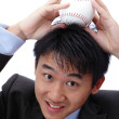Business man put baseball on his head — Stock Photo