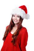 Mutlu kız gülümseyerek noel şapka — Stok fotoğraf