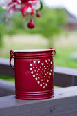 Small red bucket for candle — Stock Photo