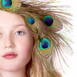 Beautiful Girl with Peacock Feather head dress — Stock Photo