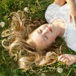 Girl sleeping in a field of grass — Stock Photo