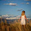 Little girl walking in a mountain landscape — Stock Photo #10967388