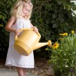 Young girl watering flowers — Stok Fotoğraf #11623777