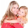 Mother hugging daughter — Stock Photo