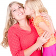 Daughter kissing mother — Stock Photo #11624786