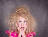 Cross eyed girl with crazy hair — Stock Photo