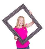 Girl holding large frame — Stock Photo